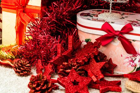 Christmas decorations and ornaments under a Christmas tree. Stok Fotoğraf - 134769139