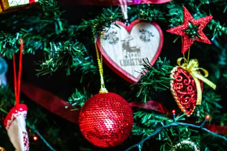 Christmas hanging decorations on fir tree. Decorated Christmas tree. Fir branches with Christmas decorations and garland. Stok Fotoğraf - 134768999