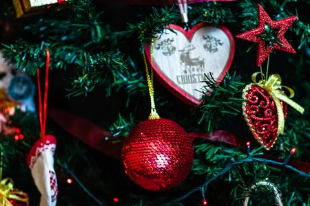 Christmas hanging decorations on fir tree. Decorated Christmas tree. Fir branches with Christmas decorations and garland. Stok Fotoğraf - 134769004