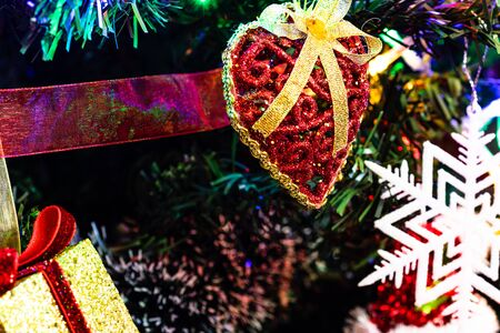Christmas hanging decorations on fir tree. Decorated Christmas tree. Fir branches with Christmas decorations and garland. Stok Fotoğraf - 134769009