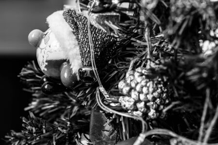 Christmas hanging decorations. Decorated Christmas tree. Fir branch with decorations. Black and white photo. Stok Fotoğraf