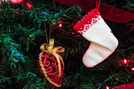 Christmas hanging decorations on fir tree. Decorated Christmas tree. Fir branches with Christmas decorations and garland. Stok Fotoğraf - 134768964