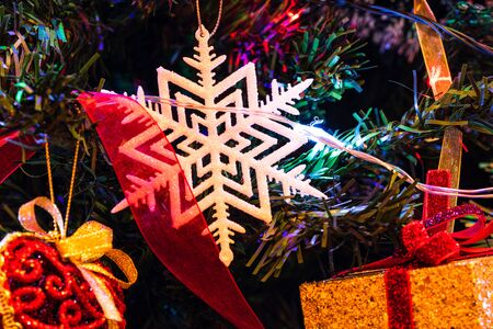 Christmas hanging decorations on fir tree. Decorated Christmas tree. Fir branches with Christmas decorations and garland. Stok Fotoğraf - 134768975