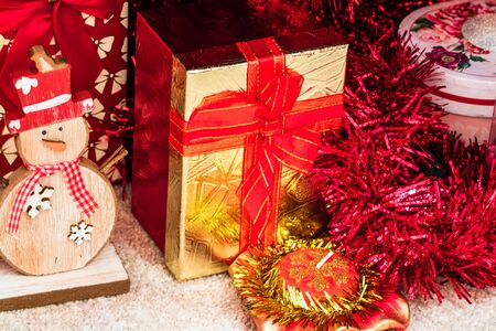 Christmas decorations and ornaments under a Christmas tree. Stok Fotoğraf - 134768869