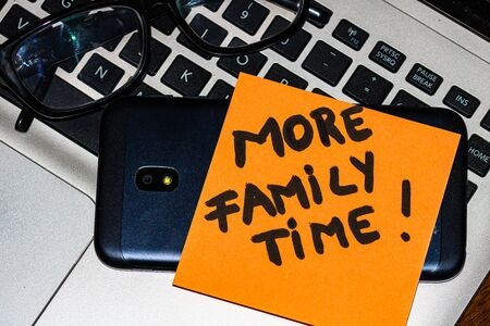 Writing on colorful sticky note More family time. Text with More family time on paper. Reklamní fotografie