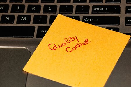 Writing on colorful sticky note Quality control. Text with Quality control on paper. Stok Fotoğraf