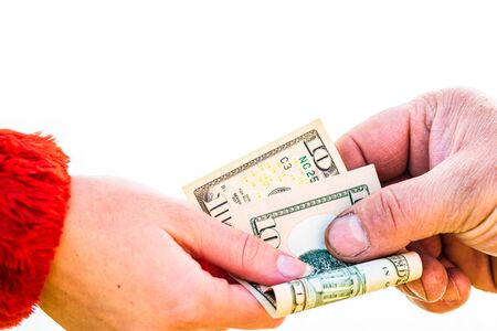 Hand giving money isolated, hard worked hand taking dollars money. Currency transfer on white background.