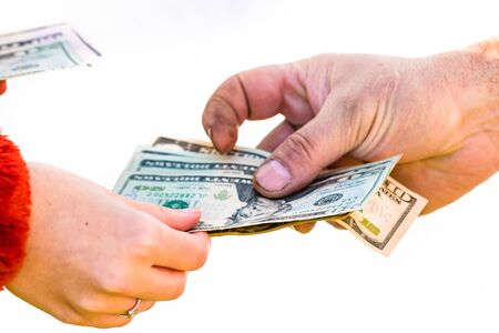 Hand giving money isolated, hard worked hand taking dollars money. Currency transfer on white background. Stock fotó