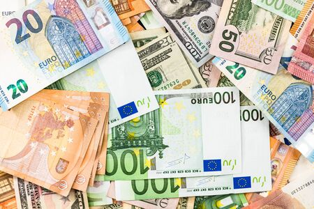 World money concept, detail on EURO and US dollar banknotes, EURO and US currency background, inflation, finance and business concept