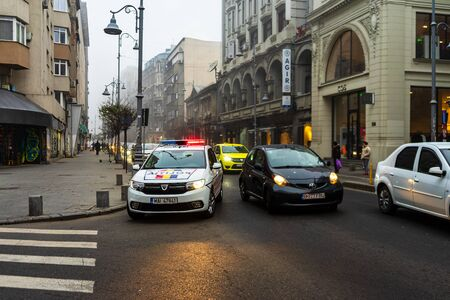 Police, and SMURD ambulance on duty. Accident on Victoriei Way (Calea Victoriei) Boulevard in Bucharest, Romania, 2020