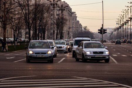 Morning and evening rush hour, stopped cars and heavy traffic on the main boulevard of Bucharest, Romania, 2020