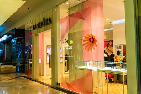 Shoppers visit the mall during winter at discount and sale season. Pandora store in AFI Cotroceni Shopping Mall in Bucharest, Romania, 2020
