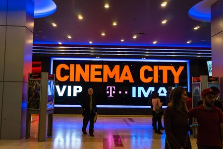 Shoppers visit the mall during winter at discount and sale season. Cinema City in AFI Cotroceni Shopping Mall in Bucharest, Romania, 2020