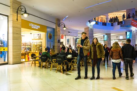 Shoppers visit the mall during winter at discount and sale season. AFI Cotroceni Shopping Mall in Bucharest, Romania, 2020 Editöryel