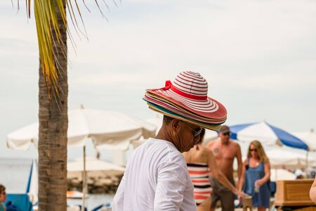 Mexican street vendor selling straw handbags and hats on the waterfront, Malecon, in Puerto Vallarta, Mexico, 2020