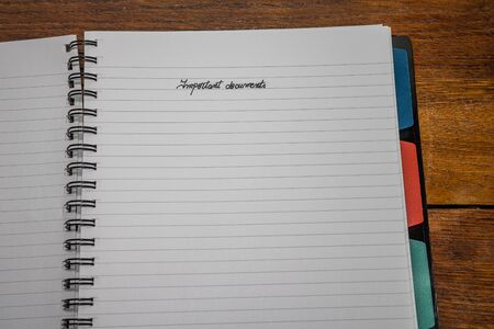 Important documents, handwriting text on page of office agenda, office spiral notebook. Copy space.