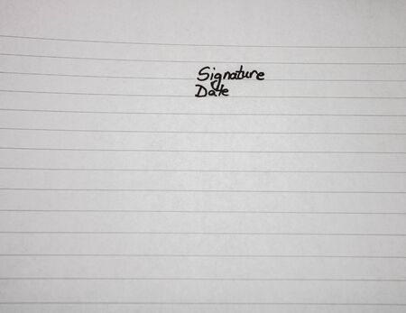 Signature and date, handwriting text on page of office agenda, office spiral notebook. Copy space.