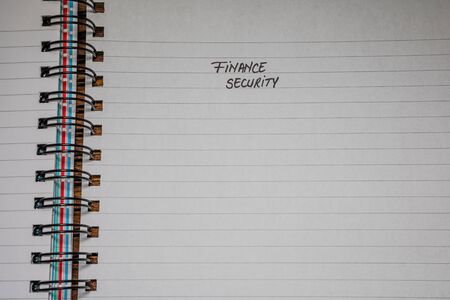 Finance security, handwriting text on page of office agenda, office spiral notebook. Copy space.
