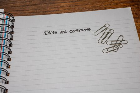 Terms and conditions, handwriting text on page of office agenda, office spiral notebook. Copy space. Stok Fotoğraf