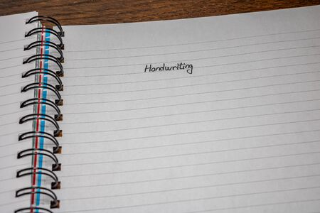Handwriting text on page of office agenda, office spiral notebook. Copy space.