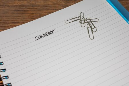 Contract, handwriting text on page of office agenda, office spiral notebook. Copy space. Stok Fotoğraf