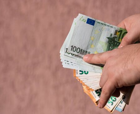 Man hands showing money, counting EURO currency, close up
