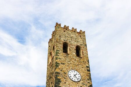 Detail view of old clock tower in Portofino village along Amalfi Coast in Cinque Terre, Italy