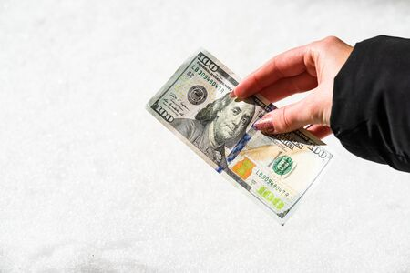 Woman hand holding and giving money. World money concept, close up of USD banknote, photo of American Dollars currency. Hand holding money, American dollars