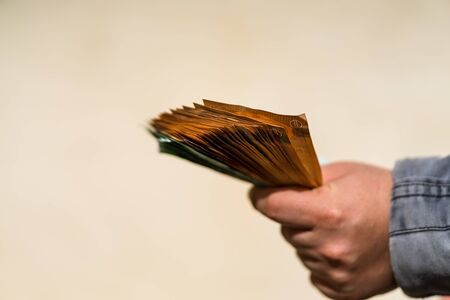 Man hand counting money for a bribe or tips. Holding EURO banknotes on a blurred background, EURO currency