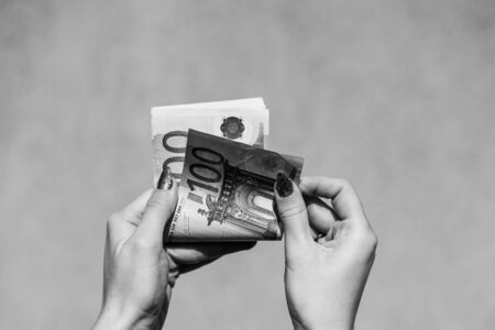 Hand couting holding and showing euro money or giving money. World money concept, 100 EURO banknotes EUR currency isolated with copy space. Concept of rich business people, saving or spending money.