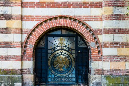 Detail on a gate of Metropolitan Orthodox Cathedral in Targoviste, Romania, 2020. Orthodox Church architecture.