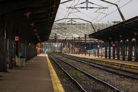 Changes and complications caused by coronavirus COVID-19 virus, world without crowds, empty train platform. No commuters, no travelers at the North Railway Station in Bucharest, Romania, 2020 Редакционное