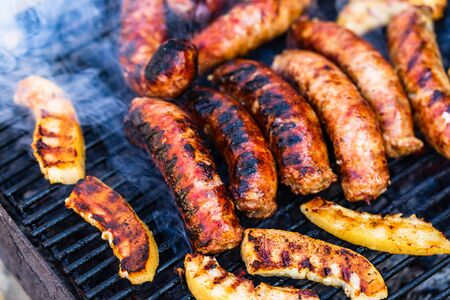 Sausages grilled on a charcoal barbeque. Top view of tasty barbecue, food concept, food on grill and detail of sausages on the grill