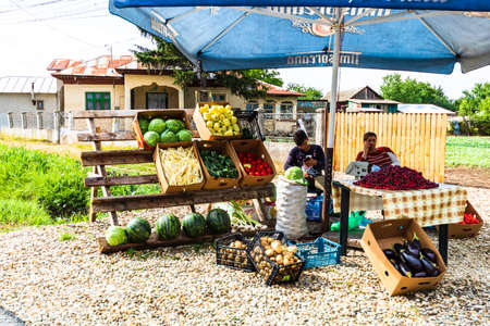 Roadside market, stalls with fruits and vegetables for selling in a village near Bucharest, Roman , 2020. Editorial