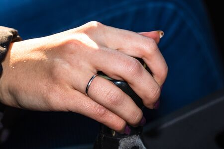 Close up shot of a woman's hand on the gear shifter while driving the car. Stock Photo