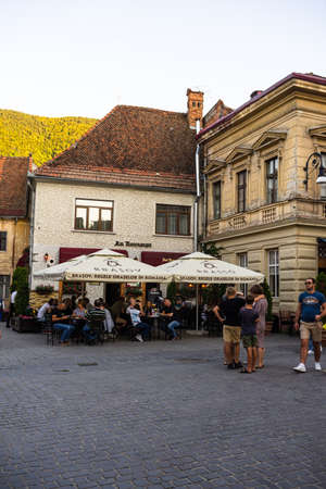 People walking, relaxing and have fun on the main streets in downtown of Brasov, Romania, 2020 Zdjęcie Seryjne