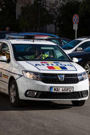Detail of police car, close up isolated. Local police car on the streets of Lugoj, Romania, 2020. Zdjęcie Seryjne
