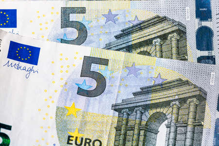 Selective focus on detail of euro banknotes. Close up macro detail of money banknotes, 5 euro isolated. World money concept, inflation and economy concept