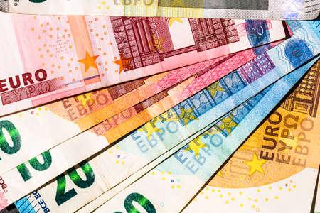 Close up of money euro banknotes, background of money euro isolated.