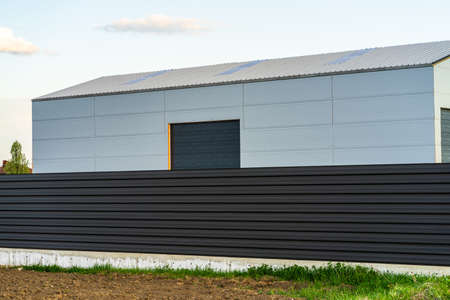 Big metal industrial storage shed building. Exterior of warehouse, no brands on storehouse with copy space. Stock fotó