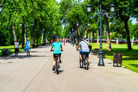 People walking, relaxing and have fun on the alleys of park and gardens of the domain from Mogosoaia in Bucharest, Romania, 2020. Editorial