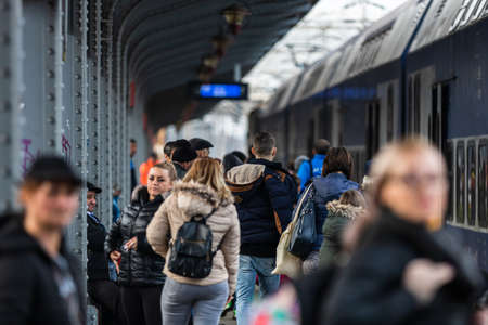 Travelers and commuters waiting for a train on the train platform of Bucharest North Railway Station (Gara de Nord Bucharest) in Bucharest, Romania, 2020