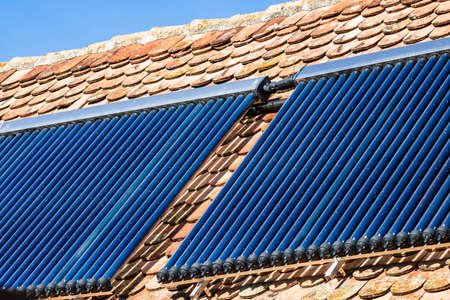 Close up of solar water heater on roof top. Solar panel for hot water, system on roof.