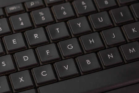Selective focus, details of laptop keyboard. Remote work, business and office concept. Stok Fotoğraf