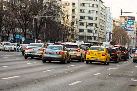 Car traffic at rush hour in downtown area of the city. Car pollution, traffic jam in the morning and evening in the capital city of Bucharest, Romania, 2020
