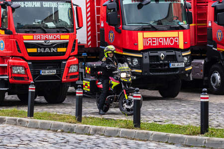 Romanian Firefighting emergency firemen (Pompierii) on motorbike parked in front of the Home Office (Ministry of the Interior) in Bucharest, Romania, 2020. SMURD emergency service on motorbike Editöryel