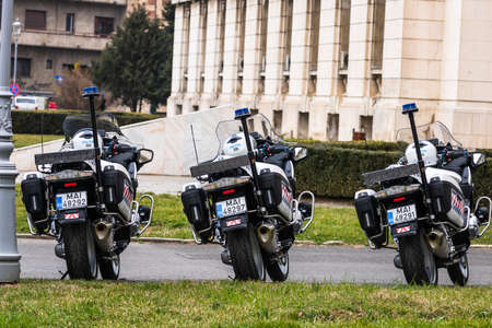 Romanian Police (Politia Rutiera) motorbikes parked in front of the Home Office (Ministry of the Interior) in Bucharest, Romania, 2020. Coronavirus worldwide outbreak crisis. Spread of the COVID-19 virus