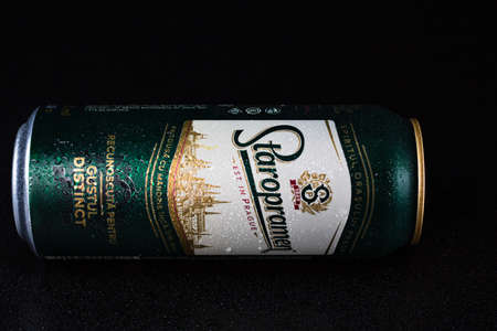 Staropramen  beer can isolated on black background. Bucharest, Romania, 2021