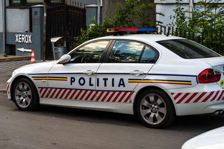 Romanian police (Politia Rutiera) car parked along the street in downtown Bucharest, Romania, 2021