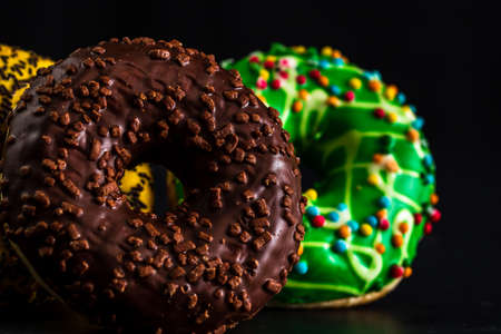 Glazed donuts with sprinkles isolated. Close up of colorful donuts. 版權商用圖片